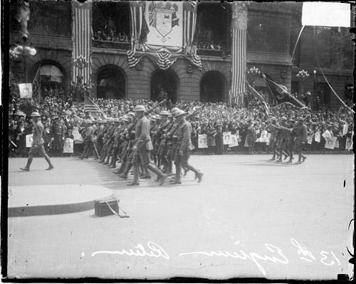 [13th Engineers Division, soldiers marching along Michigan Avenue, Loop community, upon their return home]
