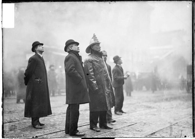 [Firefighter William Musham on the scene of the Iroquois Theater fire standing with unidentified men]