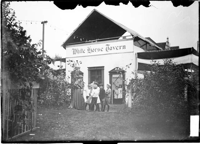 [White City amusement park, woman and children in front of the White Horse Tavern]
