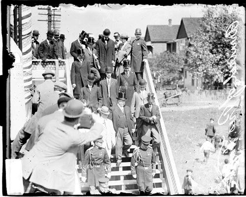 [Arrival of President Taft in Chicago, President Taft and a group of men walking down a flight of stairs]