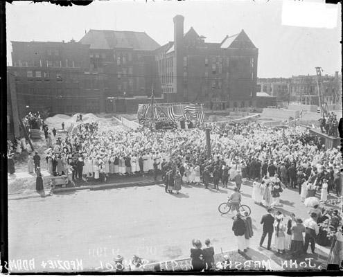 [Crowd assembled in front of John Marshall High School]
