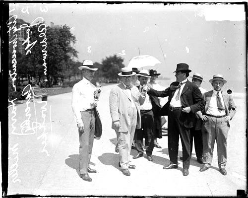 [Alderman Earl Walker, City Prosecutor Harry Miller and Judge John R. Caverly, walking on the lakefront]
