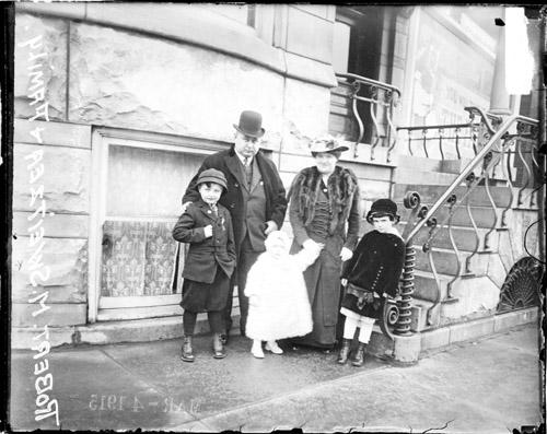 [Democratic mayoral candidate, Robert Sweitzer and family standing in front of their home]