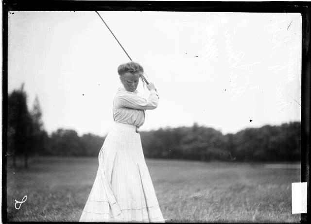 [Golfer, Miss Margaret Phelps, of Massachusetts, holding a golf club over her shoulder on the course at Midlothian Country Club]