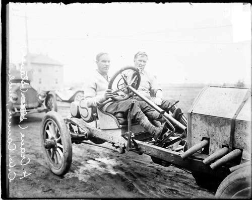[Automobile driver A. Crane and automobile mechanic C. W. Canner sitting in a Staver automobile parked on a road in Elgin]