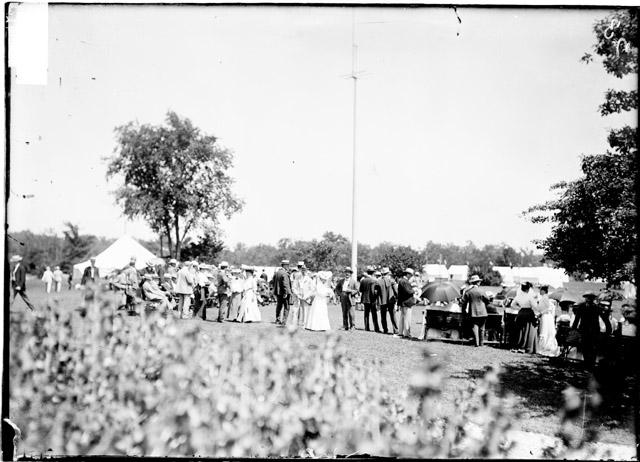 [Golf, Glen View Club, men and women standing on the grounds of a golf course]