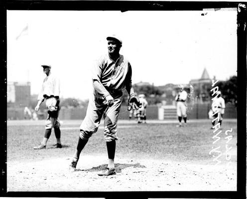 [Baseball catcher, Douglas, New York Giants, following through after throwing a baseballon the field at Weeghman Field]