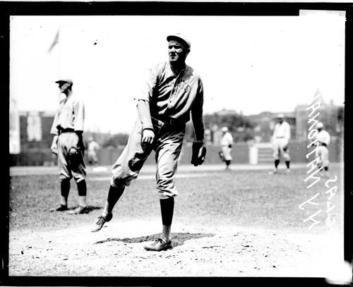 [Baseball catcher, Douglas, New York Giants, following through after throwing a baseball at Weeghman Field]
