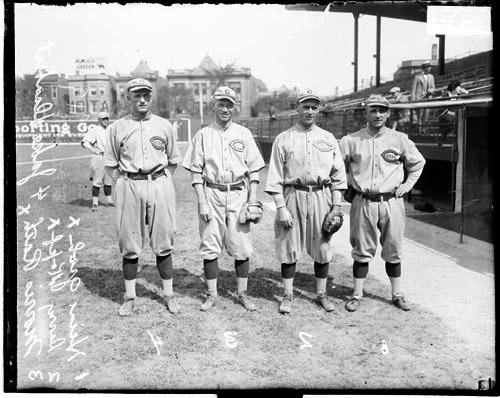 [Baseball infielders Daubert Rath, Kipt, and Groh, Cincinnati Reds, on the field at Weeghman Field]