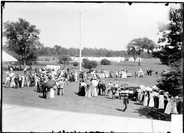 [Golf, Glen View Club, men and women standing in a semi-circle]