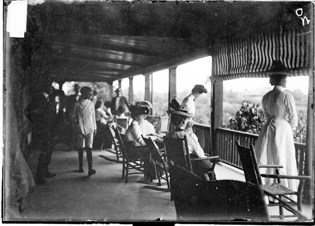 [Golf, Glen View Club, women looking out from clubhouse porch]