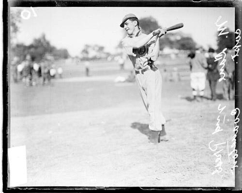 [2nd Pres., Evanston baseball captain M. Lane following through after swinging a baseball bat]