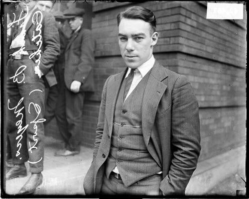 [Baseball catcher, Frank B. Meyers, Cubs, wearing a suit, standing in front of a building]