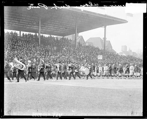 [Baseball, Chicago Cubs following a marching band at Weeghman Park on opening day]