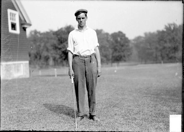 [Golfer, H. Hollibird, Jr., standing outdoors, Midlothian Country Club]