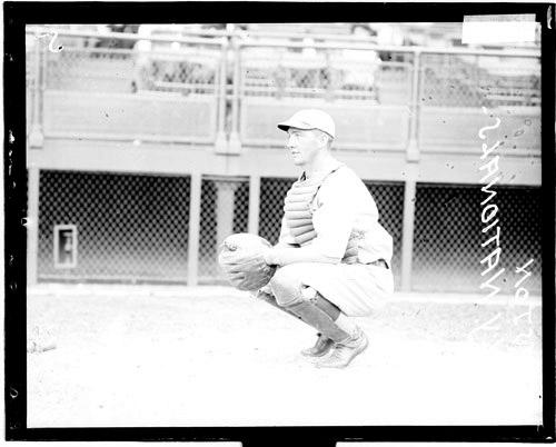 [Baseball catcher, Gaston, New York Giants, crouching in profile on the field at Weeghman Field]