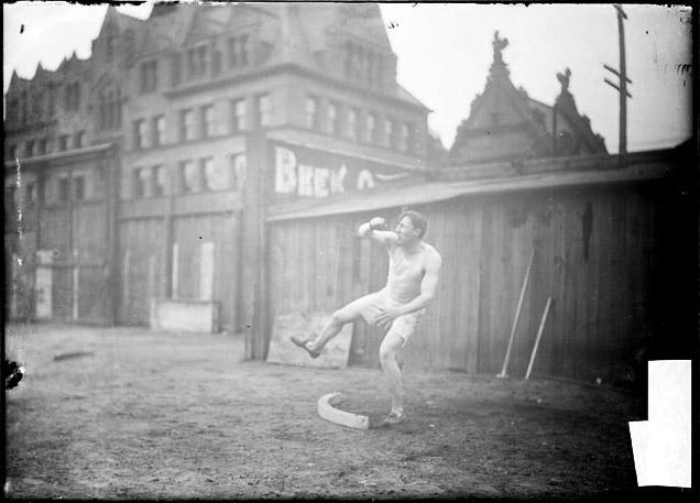 [Athlete, C. Russell, discus throwing after release, Marshall Field]