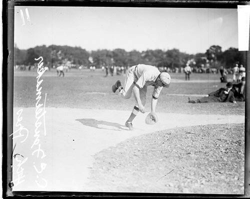 [4th Pres. baseball player C. E. Fenstermaker moving forward in a fielding position, standing on a baseball field]