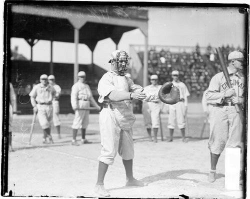 [Admiral (George) Schlei, Cincinnati Reds catcher, holding his hands in front of him, standing behind home plate]