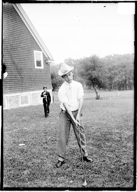 [Golfer, standing outdoors and holding a golf club, Midlothian Country Club]