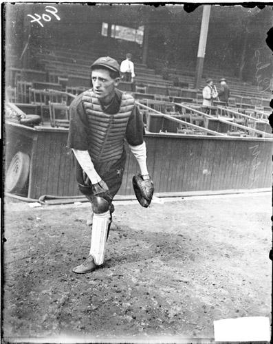 [Baseball catcher Chapman, Cubs, following through after throwing a baseball on the field at West Side Grounds]