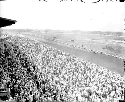 [Horse Racing, Derby Day, Washington Park Track, crowds standing in front of grandstands and in the grandstands, light exposure]
