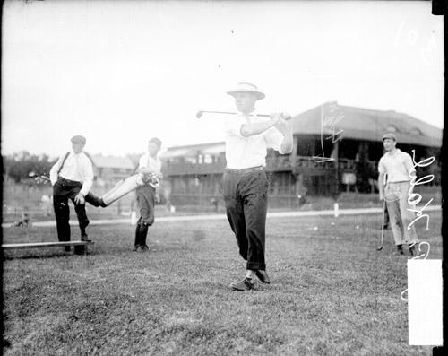 [Golfer J. P. Kohl holding a golf club over his shoulder, standing in a follow-through position]