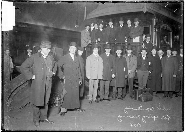 [Baseball team, Chicago White Sox, leaving for spring training, players gathered on railroad platform, train conductor with hands on his hips]