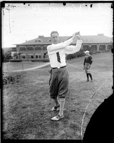 [Golfer Fred J. Wright, Jr. following through after swinging a golf club on the grounds of the Skokie Golf Club]