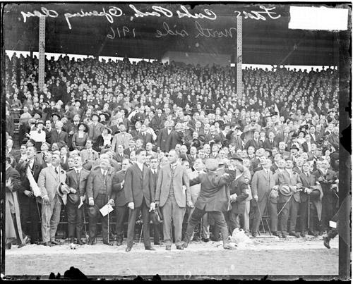 [Baseball, fans standing in the grandstands at Weeghman Park on opening day]