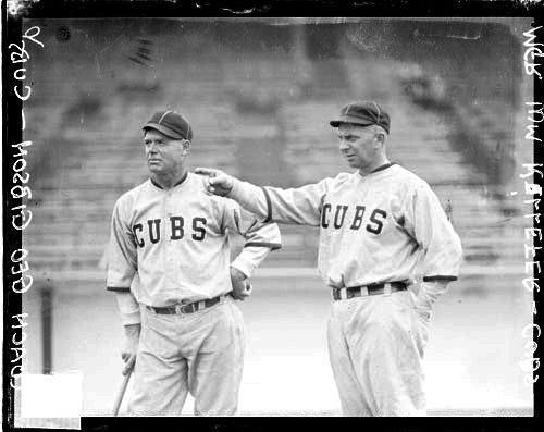[Baseball coach George Gibson and manager Bill Killefer, Cubs, standing on the field at Weeghman Field]