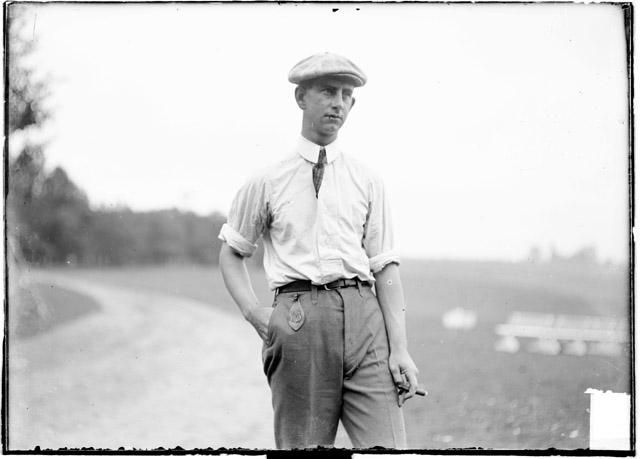 [Golfer, A. C. Follefson standing outdoors, Midlothian Country Club]