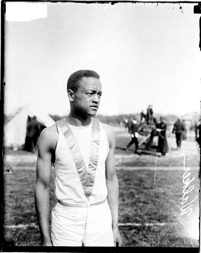 [African American athlete Walker standing on an athletic field]