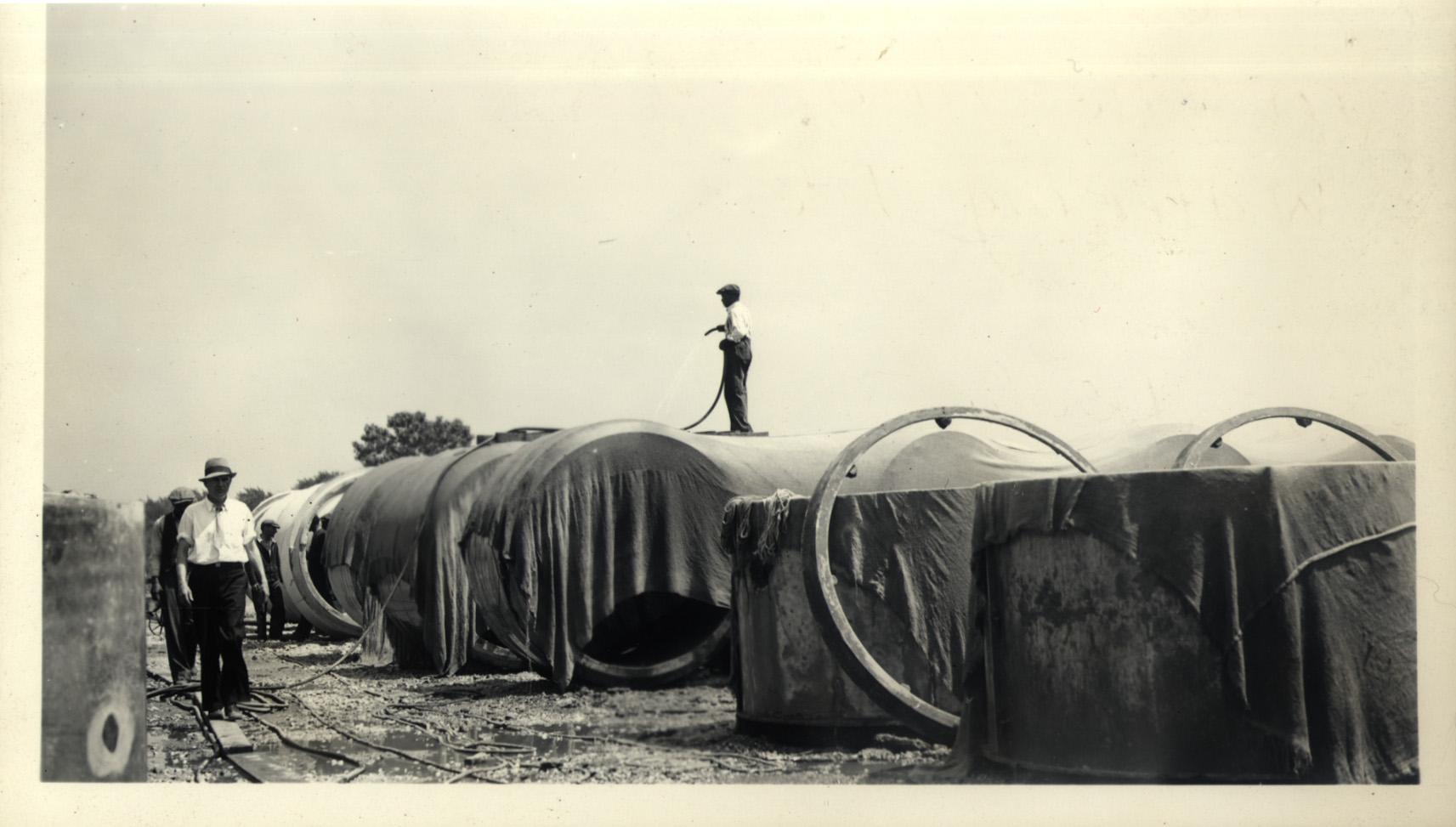 103rd Street and Rockwell Street, Pipe Yard, watering pipe, June 16, 1936