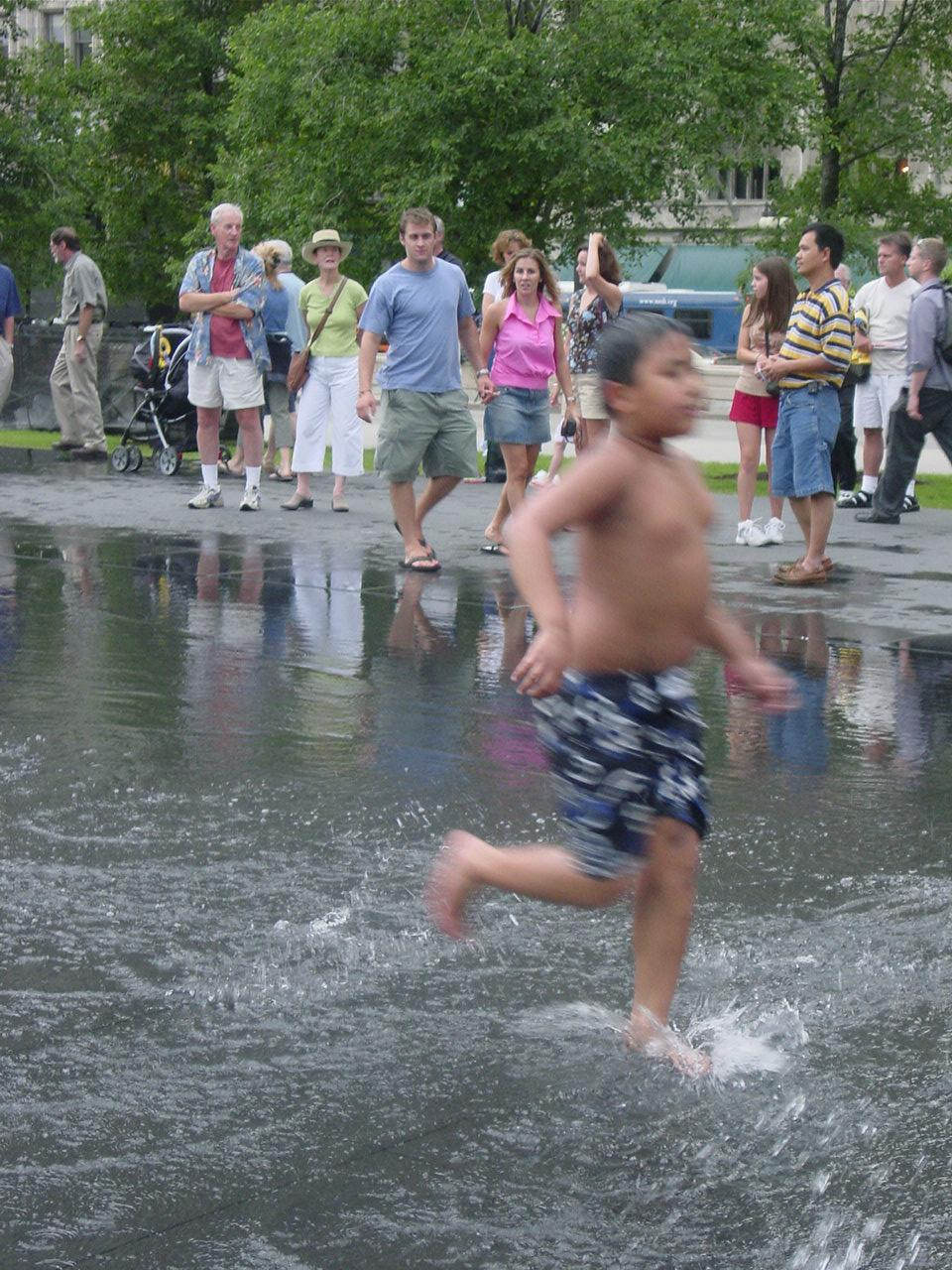 Crown Fountain, a child plays in the reflecting pool, July 22, 2004