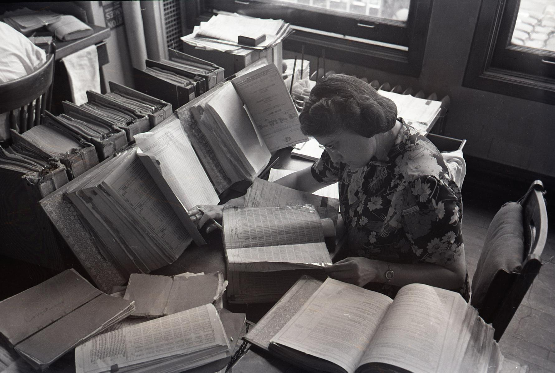 Woman clerk examining books at Freight Rate Department, Burlington Railroad office, Chicago, June 1948