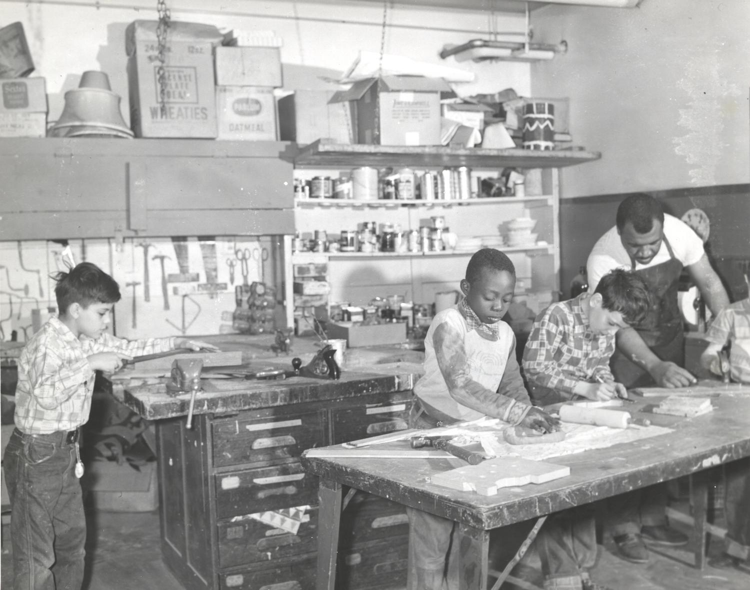 Boys working in craft shop