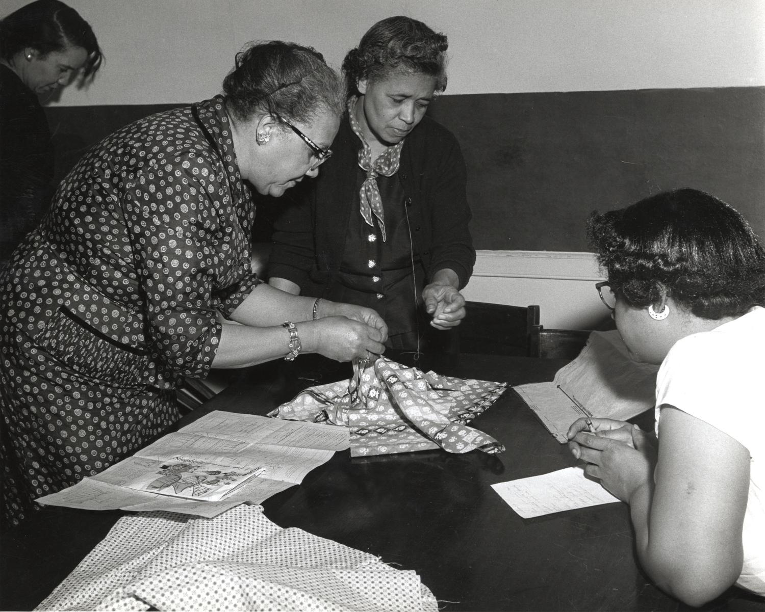 Older African American women working on sewing projects