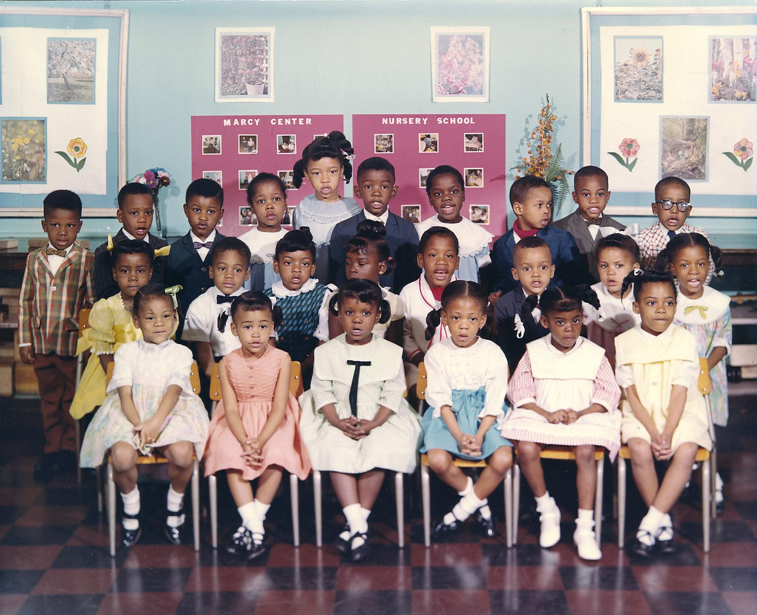 Children from the Marcy Center Nursery School posing in three rows