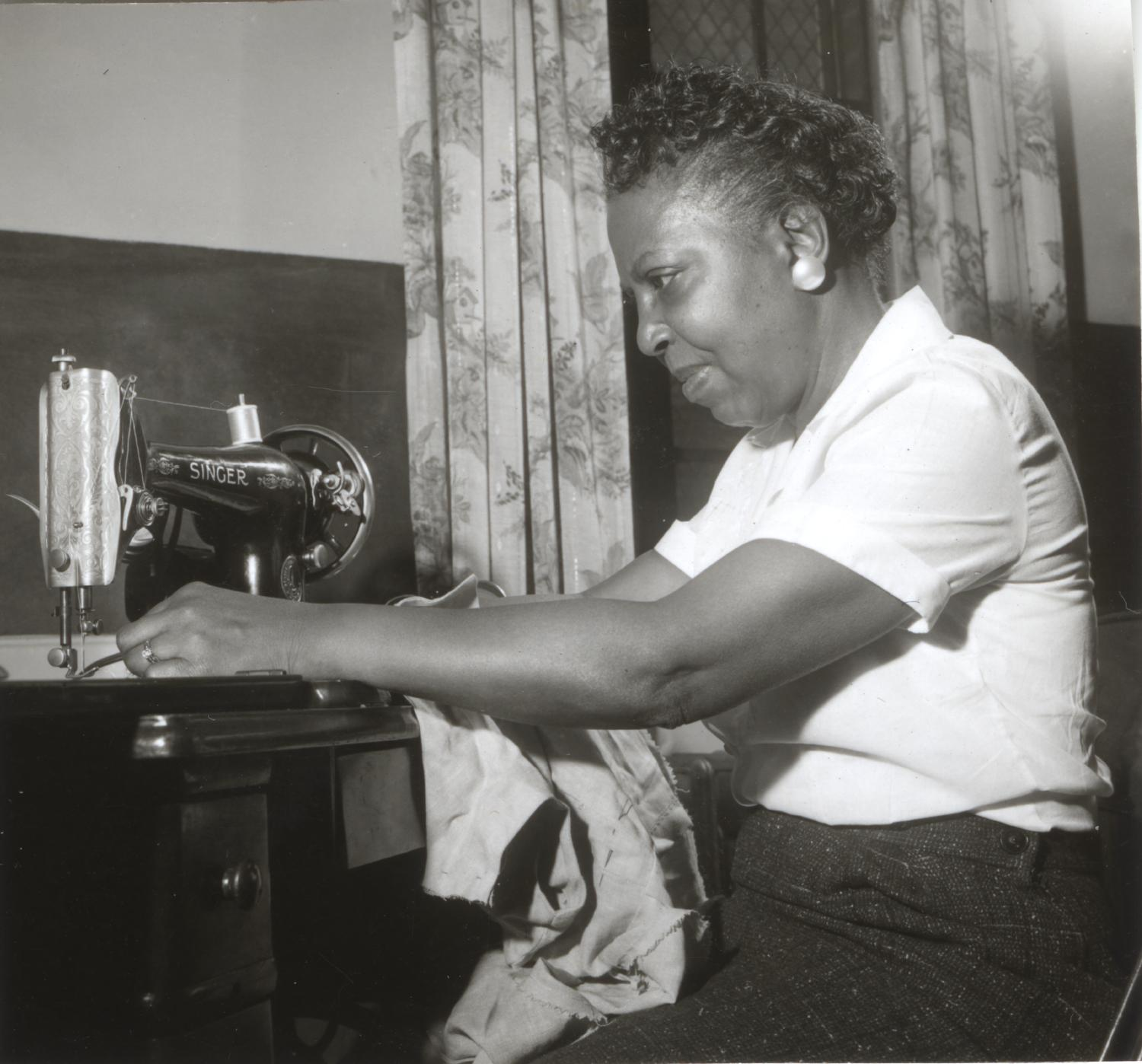 Liz Snyder sewing on a Singer sewing machine
