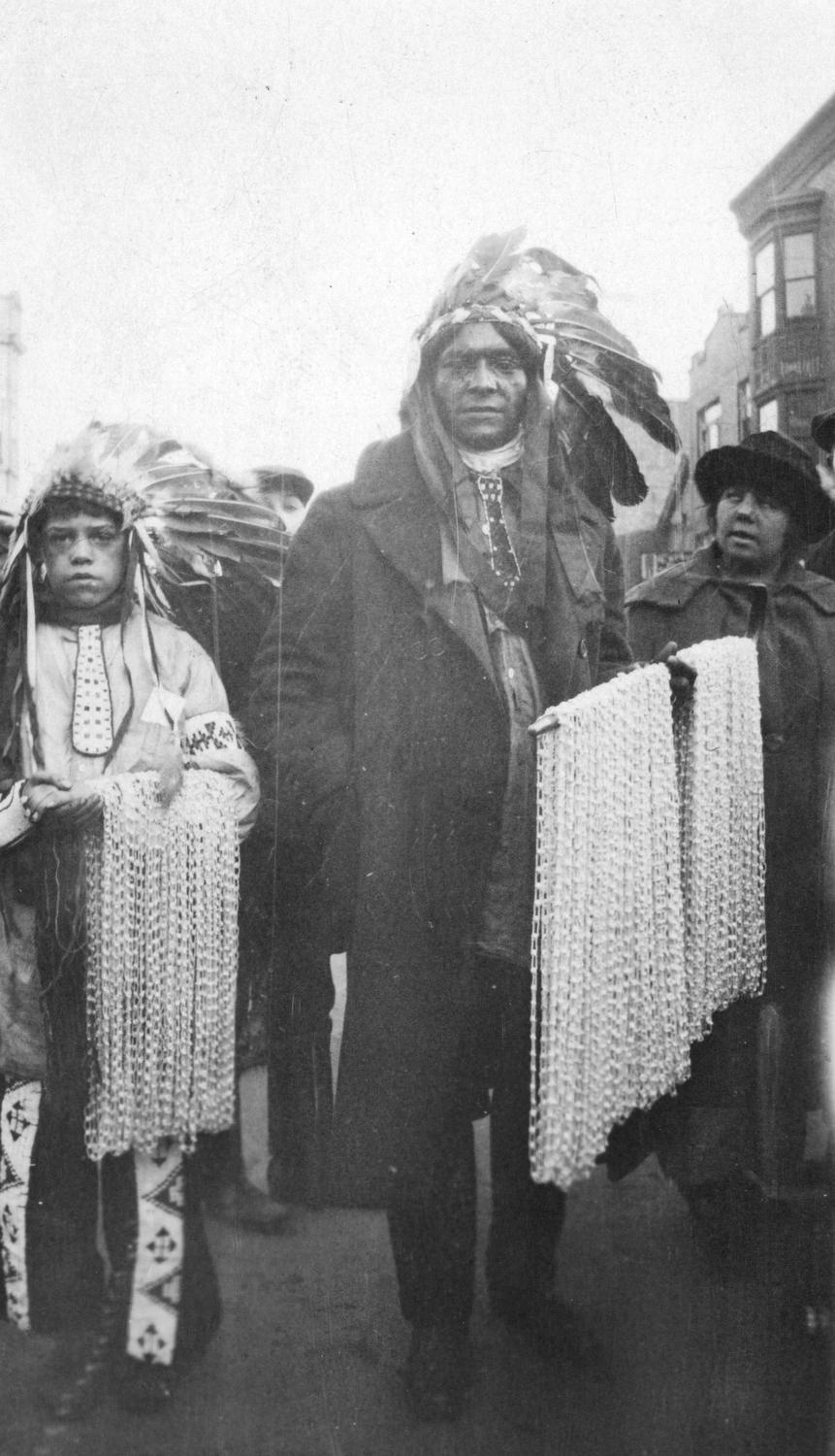 American Indians selling beads