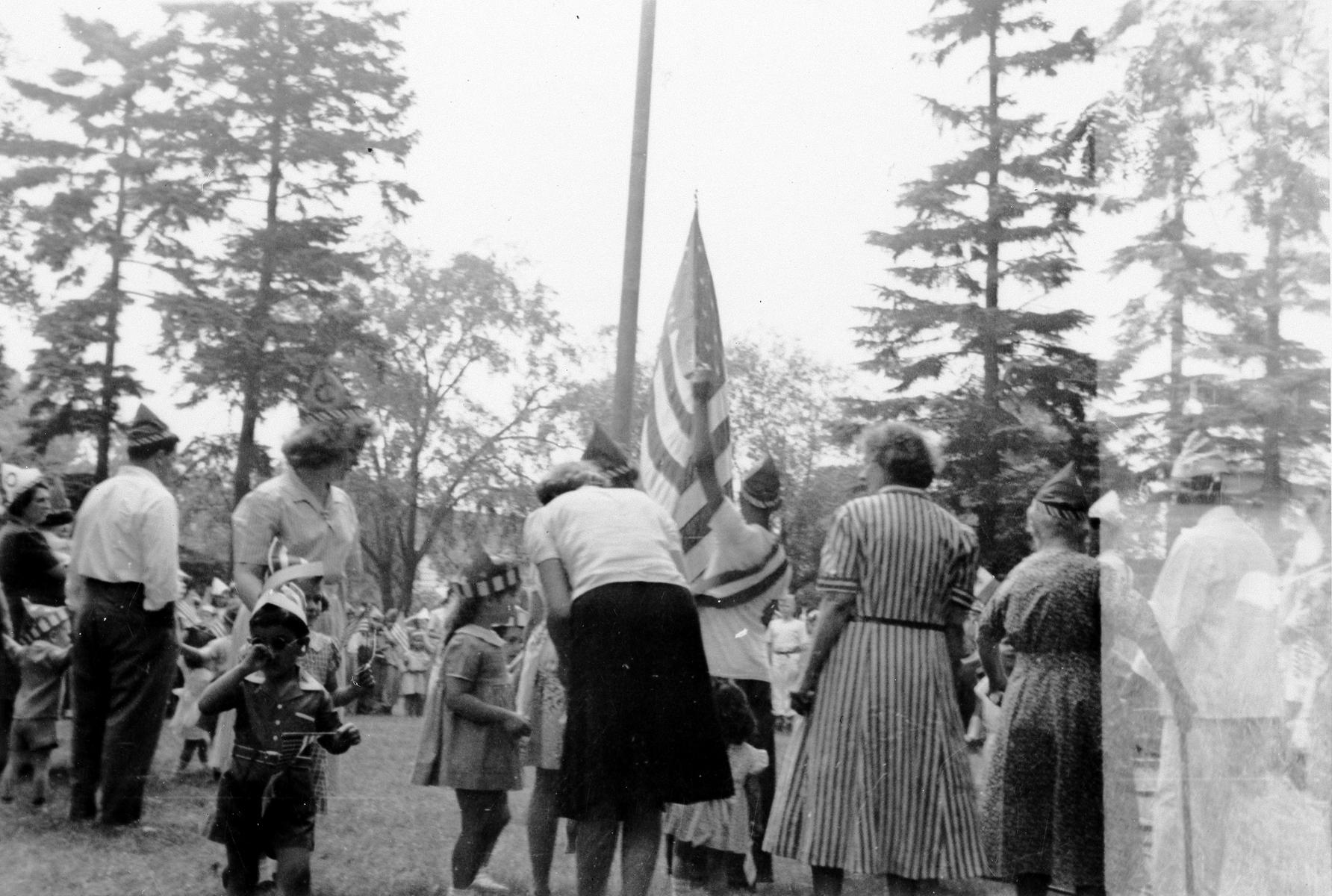 Adults at flag raising
