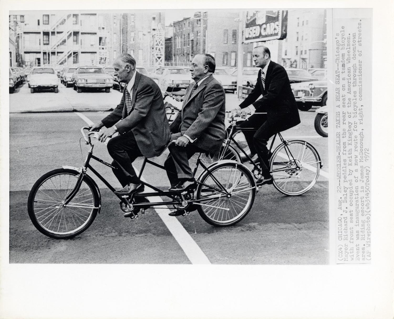 Richard J Daley on a tandem bike with Keith Kingbey