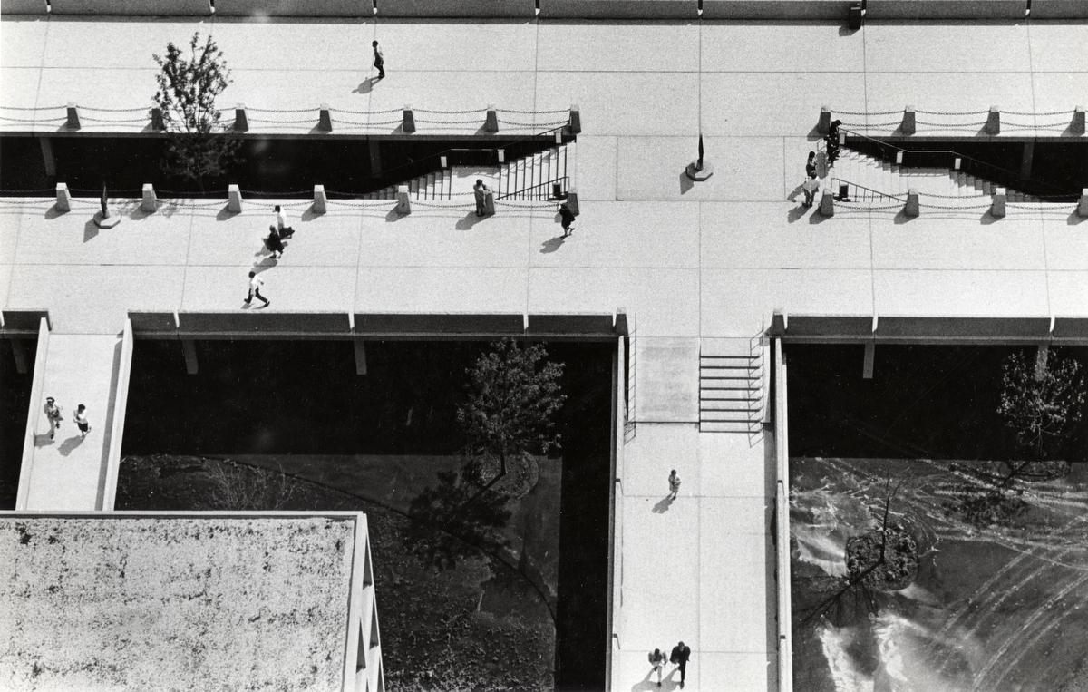Aerial view of elevated walkway with pedestrians, ca. 1966.