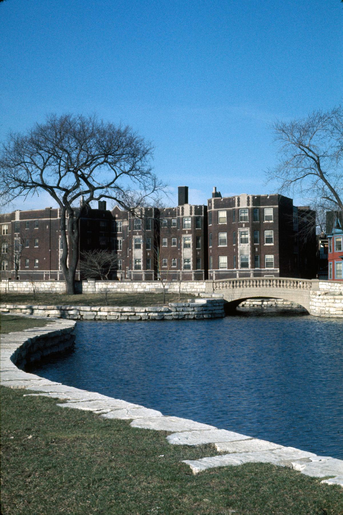 Auburn Park lagoon and apartment building