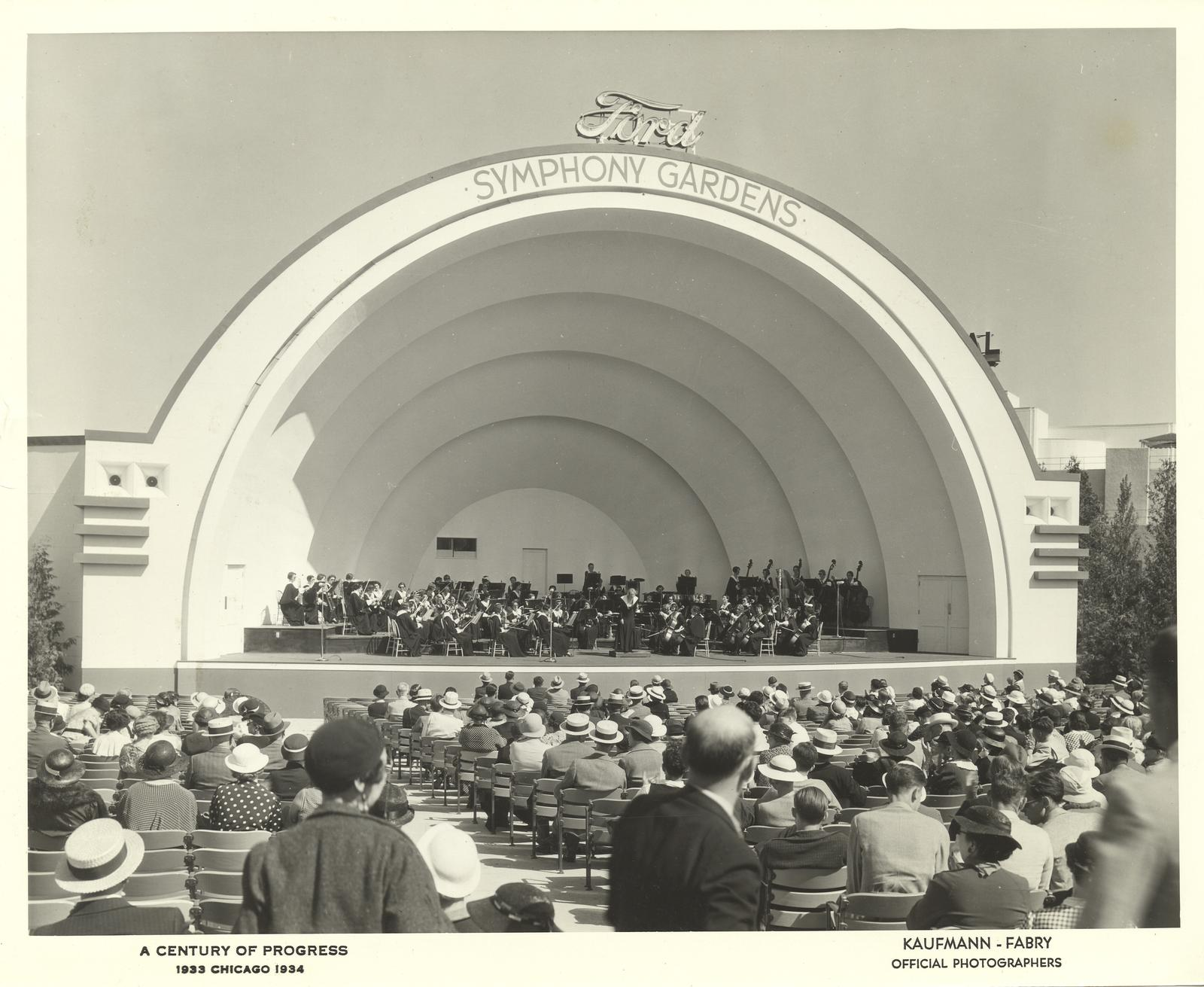 [An audience view of an orchestral performance at Ford's Symphony Gardens bandshell at the Century of Progress International Exposition, 1933-1934.]