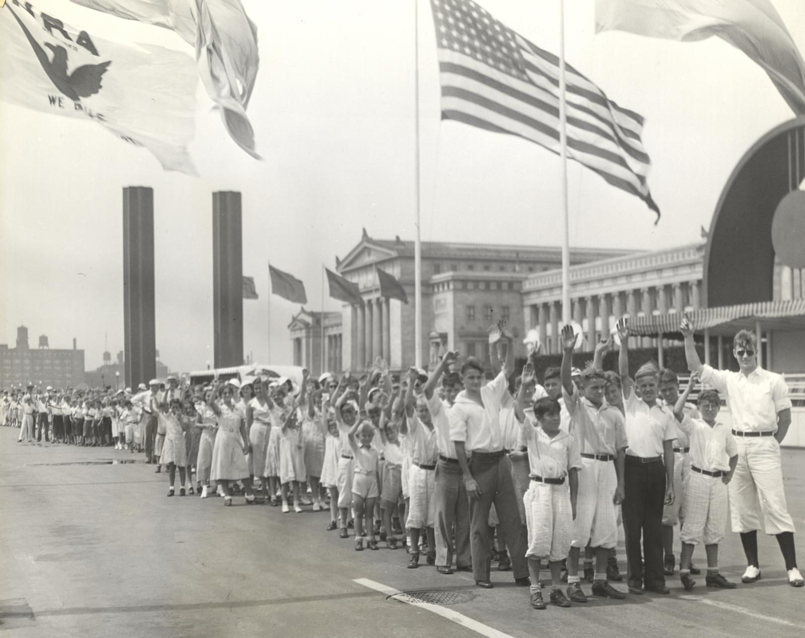 """""""More than 1,000 orphans from a score of orphan institutions in Chicago and vicinity were guests of the World's Fair yesterday (Wednesday). The happy children are shown entering the Fourteenth street gate of the Fair. They spent the entire afternoon on a"""