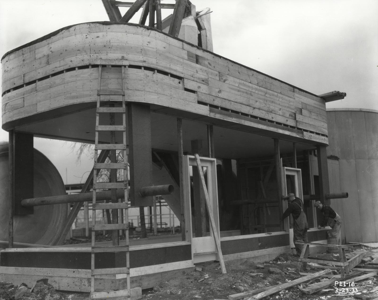 [Construction of a giant toy wagon in preparation for the Enchanted Island exhibit at A Century of Progress. The photo was taken in March of 1933, a few months before the grand opening of the Fair.]