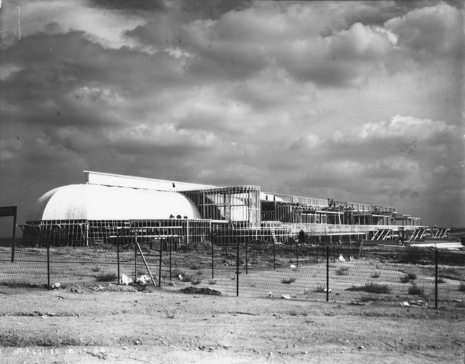 [Agricultural building under construction in preparation for A Century of Progress.]