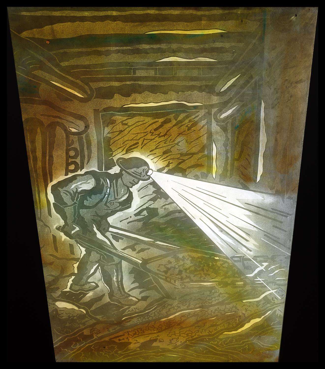 [A mural representing industry and industrialization. This picture depicts a coal miner working in a mine shaft.]